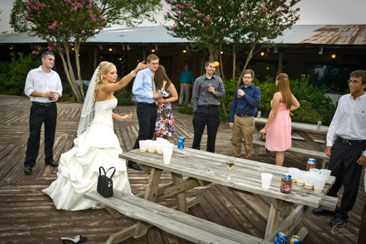 Bride Playing Beer Pong During Their Safari Texas Ranch Wedding