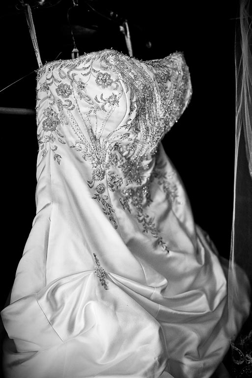 Gorgeous brides wedding dress hanging and waiting for the bride.