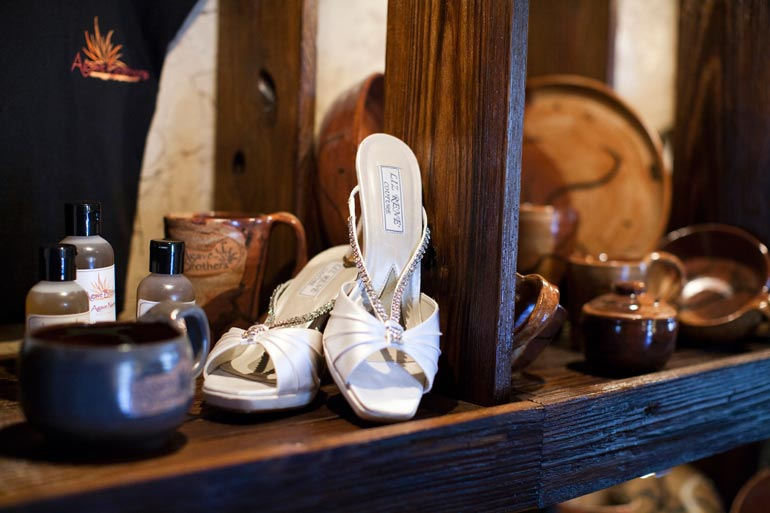 Awesome photo of the brides shoes on an antique shelf.