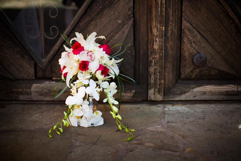 Wedding Floral Bouquet in front of the rustic doors.