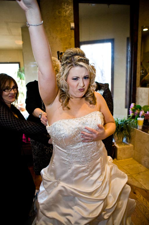 Bride having a good time while getting dressed.