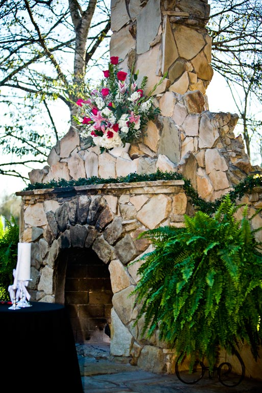 Outdoor fireplace at Agave Road decorated for the wedding ceremony.