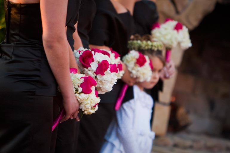 Bridesmaids holding their boquets at the outdoor wedding at Agave Road.