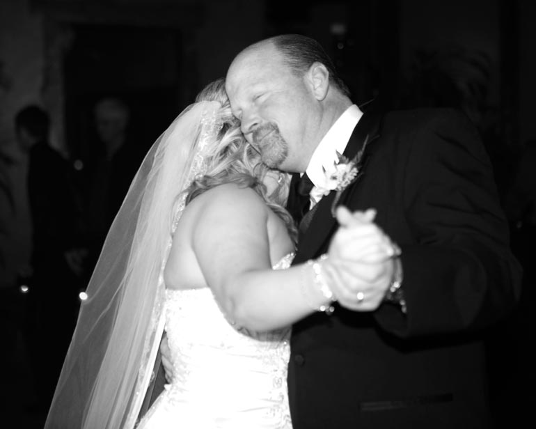 Father daughter dance during her wedding.