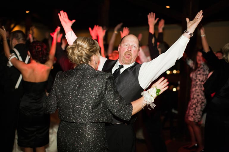 Father of the bride having a great time during his daughters reception at Agave Road.