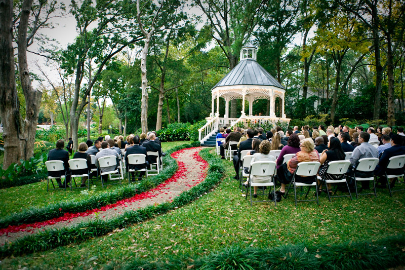 Breathtaking Outdoor Wedding Venue With A Path Lined Red Roses